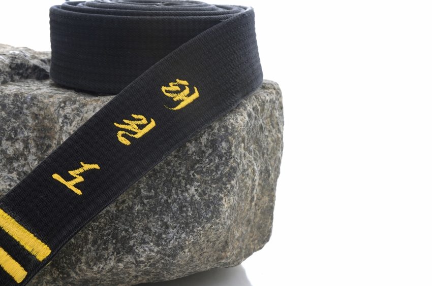Black belt on a rock (tae kwon do embroidered on the belt).